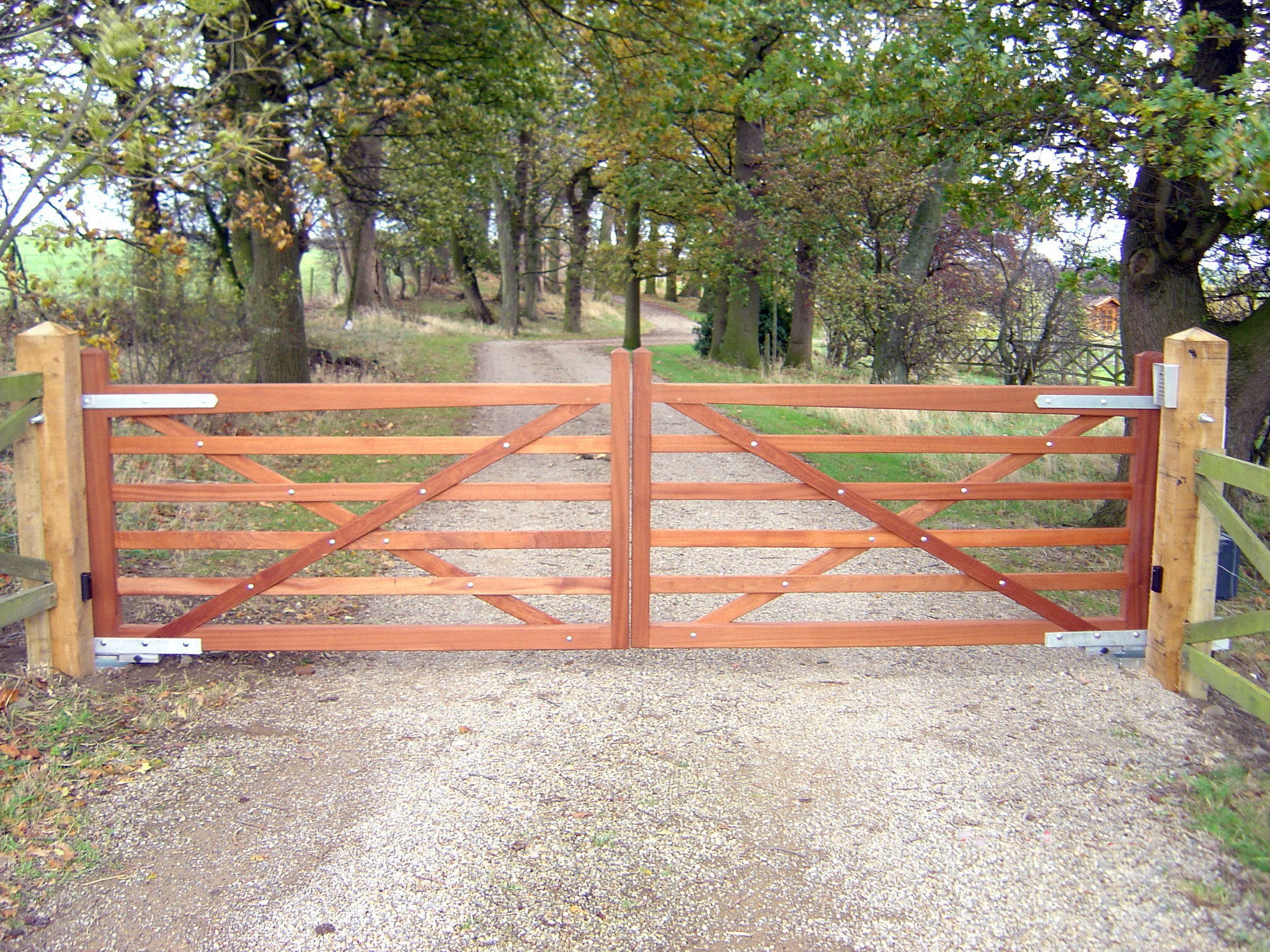 Wooden gates driveway field and garden